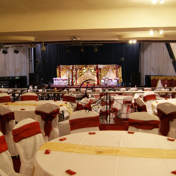 Full Venue with red and gold theme and Gold Zali Mandap
