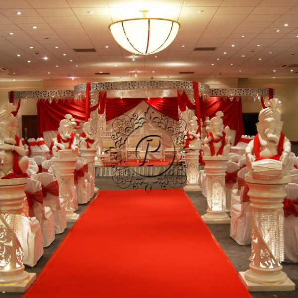 White Zali Mandap with walkway dressed in a red and white theme
