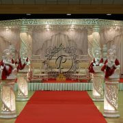 White Hexagon Zali Mandap in a red and white theme with pillars and red carpet